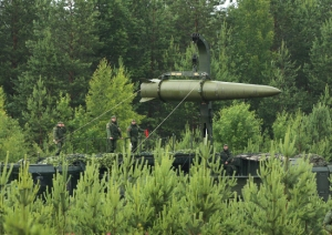 Iskander-M Ballistic Missile Being Transloaded (photo: Mil.ru)