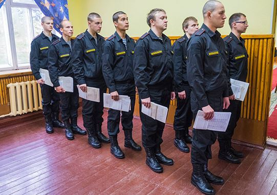 Northern Fleet draftees lined up with their paperwork in hand