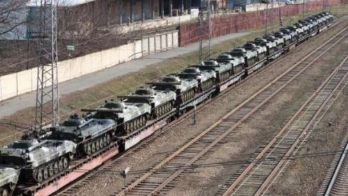 Rail cars carrying armored vehicles