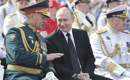 Putin flanked by Defense Minister Shoygu and Navy CINC Admiral Vladimir Korolev