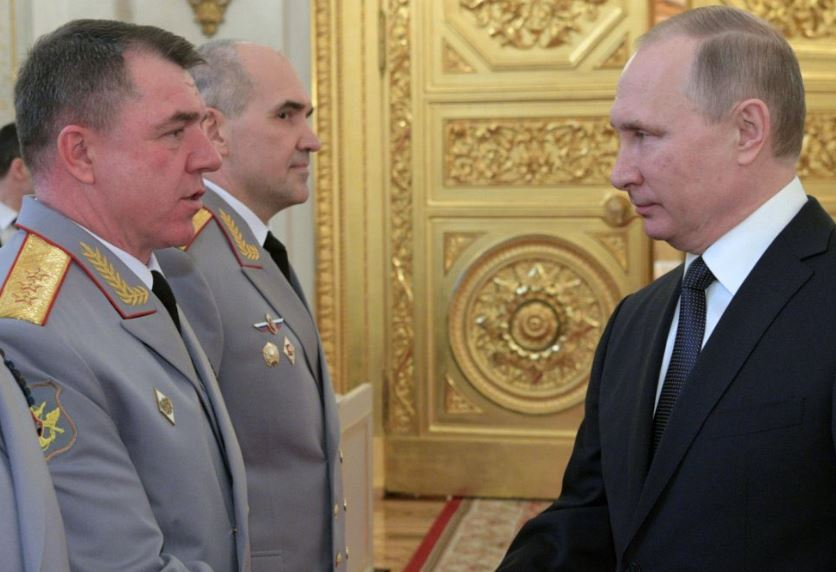 Zhuravlev shaking hands with Putin in 2017