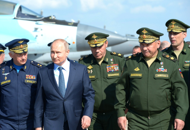 Putin walks the flight line at Akhtubinsk on May 14
